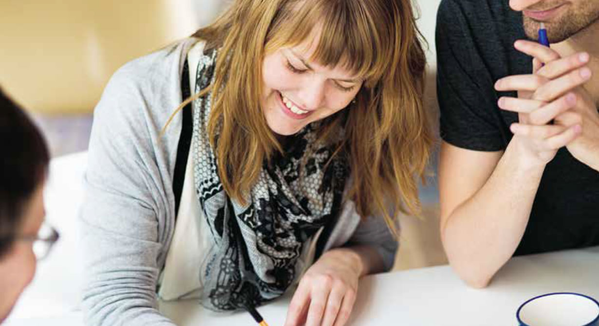 Photo: Girl writing and smiling